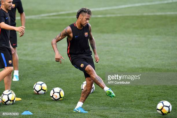 Barcelona's Brazilian forward Neymar kicks the ball during a training session at the Red Bull Arena in Harrison New Jersey on July 21 a day before...