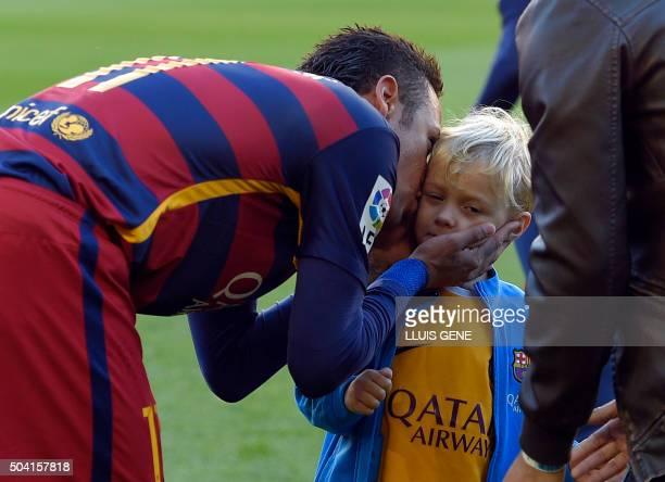 Barcelona's Brazilian forward Neymar kises his son before the Spanish league football match FC Barcelona vs Granada CF at the Camp Nou stadium in...
