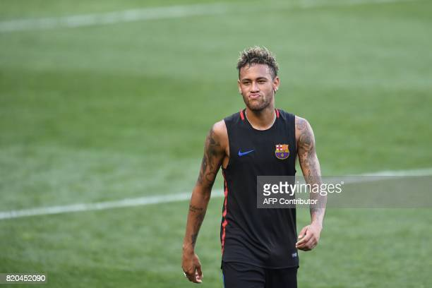 Barcelona's Brazilian forward Neymar leaves the field after a training session at the Red Bull Arena in Harrison New Jersey on July 21 a day before...