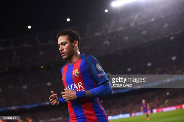 Barcelona's Brazilian forward Neymar leaves the pitch at the end of first half during the UEFA Champions League round of 16 second leg football match...
