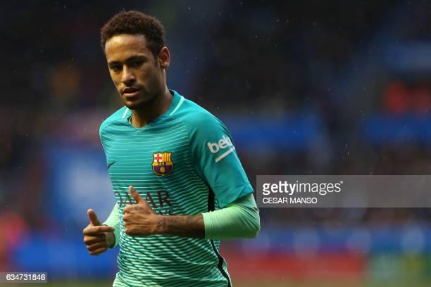 Barcelona's Brazilian forward Neymar looks on during the Spanish league football match Deportivo Alaves vs FC Barcelona at the Mendizorroza stadium...