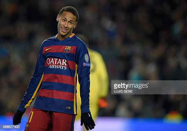 Barcelona's Brazilian forward Neymar reacts after missing a goal opportunity during the UEFA Champions League Group E football match FC Barcelona vs...