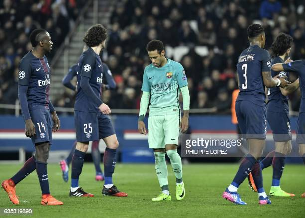 TOPSHOT Barcelona's Brazilian forward Neymar reacts during the UEFA Champions League round of 16 first leg football match between Paris SaintGermain...