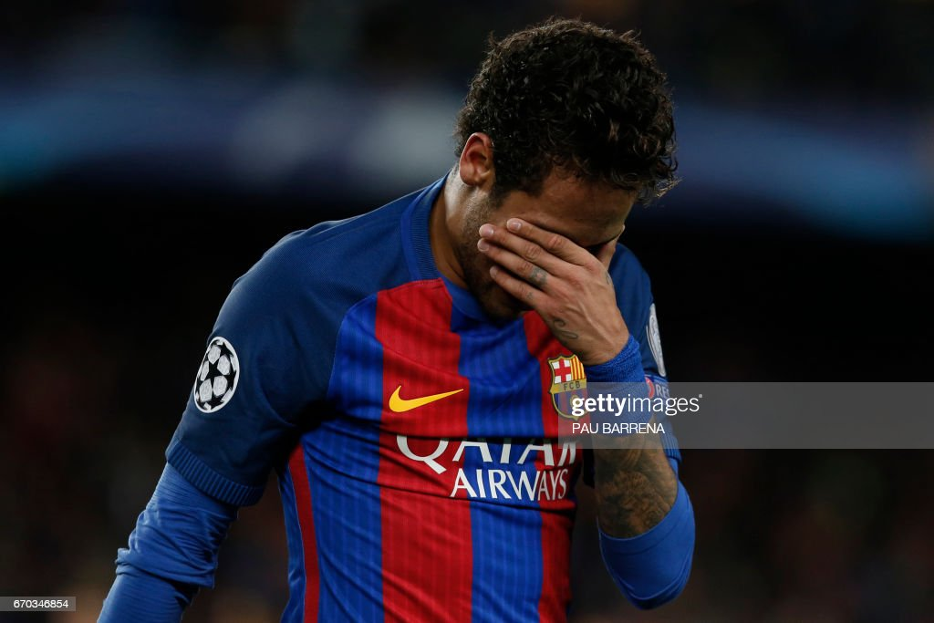 TOPSHOT - Barcelona's Brazilian forward Neymar reacts to their disqualification by Juventus at the end of the UEFA Champions League quarter-final second leg football match FC Barcelona vs Juventus at the Camp Nou stadium in Barcelona on April 19, 2017. The game ended with a draw and Juventus is qualified for the semis. /