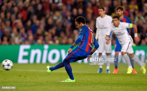 Barcelona's Brazilian forward Neymar shoots a penalty kick to score a goal during the UEFA Champions League round of 16 second leg football match FC...