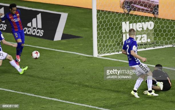 Barcelona's Brazilian forward Neymar shoots to score their second goal during the Spanish Copa del Rey final football match FC Barcelona vs Deportivo...