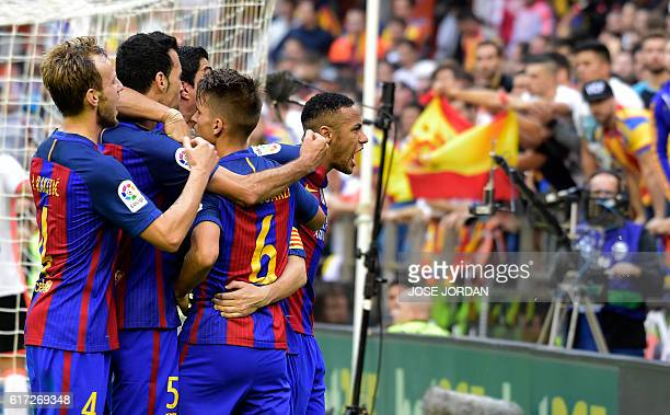 TOPSHOT Barcelona's Brazilian forward Neymar shouts at Valencia's suporters after they thrown an object at teammates during the Spanish league...