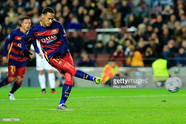 Barcelona's Brazilian forward Neymar takes a penalty kick during the UEFA Champions League Group E football match FC Barcelona vs AS Roma at the Camp...