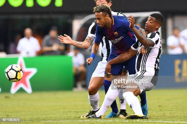 Barcelona's Brazilian forward Neymar vies for the ball with Juventus players during the International Champions Cup match between Juventus FC and FC...