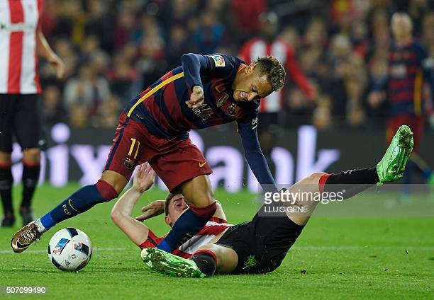 Barcelona's Brazilian forward Neymar vies with Athletic Bilbao's French defender Aymeric Laporte during the Spanish Copa del Rey quarterfinals second...