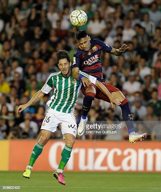Barcelona's Brazilian forward Neymar vies with Betis' midfielder Alvaro Cejudo during the Spanish league football match Real Betis Balompie vs FC...