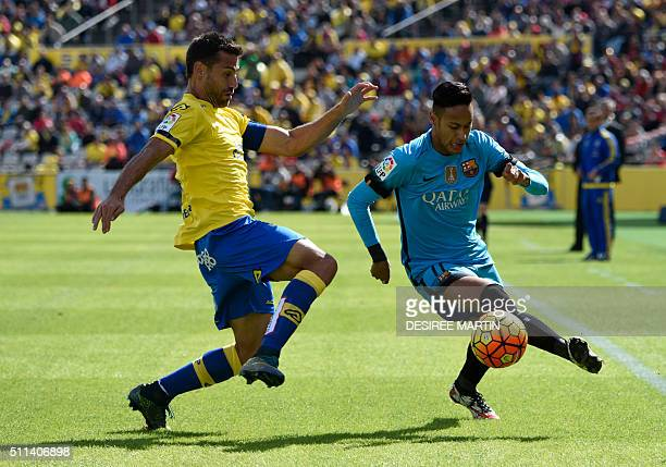 Barcelona's Brazilian forward Neymar vies with Las Palmas' defender David Garcia during the Spanish league football match UD Las Palmas vs FC...