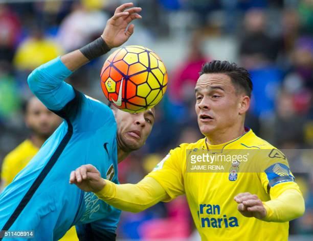 Barcelona's Brazilian forward Neymar vies with Las Palmas' defender David Garcia during the Spanish league football match UD Las Palmas vs FC...