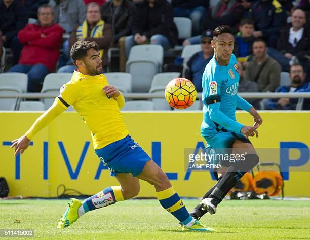 Barcelona's Brazilian forward Neymar vies with Las Palmas' forward Pedro Tanasu 'Tana' during the Spanish league football match UD Las Palmas vs FC...
