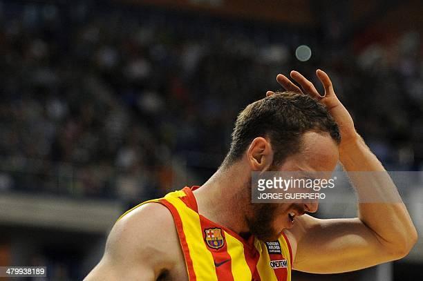 Barcelona's Brazilian guard Marcelinho Huertas gestures during the Euroleague group E TOP 16 basketball match Unicaja Malaga vs FCB Barcelona at the...