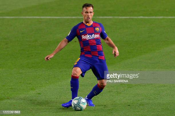 Barcelona's Brazilian midfielder Arthur controls the ball during the Spanish league football match between FC Barcelona and Athletic Club Bilbao at...