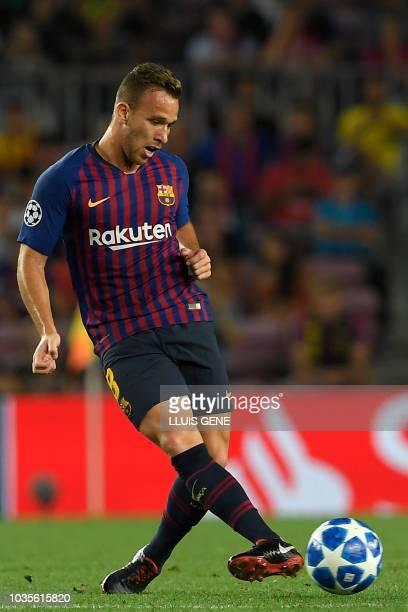 Barcelona's Brazilian midfielder Arthur kicks the ball during the UEFA Champions' League group B football match FC Barcelona against PSV Eindhoven at...