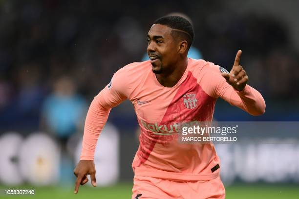 Barcelona's Brazilian midfielder Malcom celebrates after opening the scoring during the UEFA Champions League group B football match Inter Milan vs...