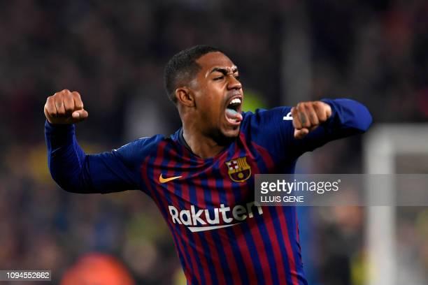 Barcelona's Brazilian midfielder Malcom celebrates after scoring during the Spanish Copa del Rey semi-final first leg football match between FC...