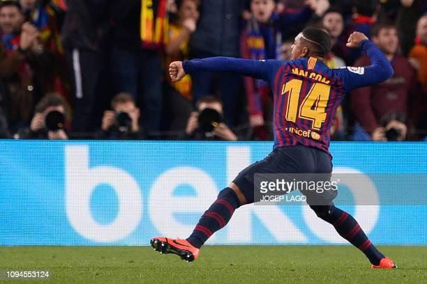 Barcelona's Brazilian midfielder Malcom celebrates his goal during the Spanish Copa del Rey semi-final first leg football match between FC Barcelona...
