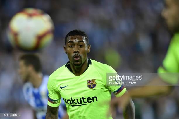 Barcelona's Brazilian midfielder Malcom eyes the ball during the Spanish league football match Club Deportivo Leganes SAD against FC Barcelona at the...