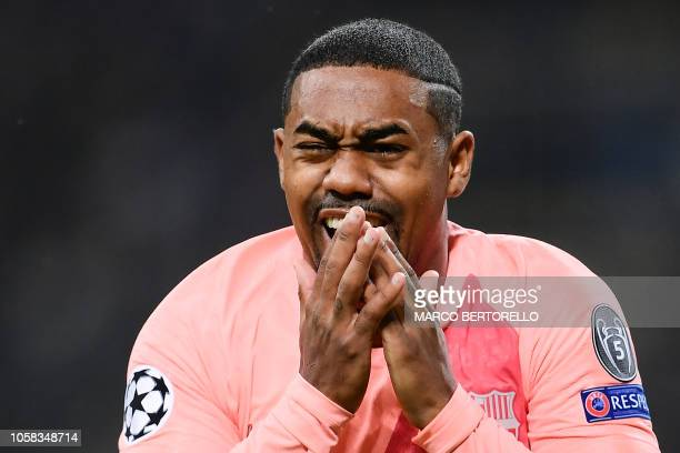 Barcelona's Brazilian midfielder Malcom reacts after opening the scoring during the UEFA Champions League group B football match Inter Milan vs...