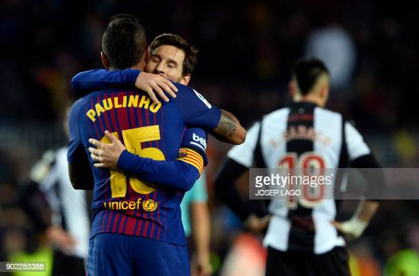 Barcelona's Brazilian midfielder Paulinho celebrates a goal with Barcelona's Argentinian forward Lionel Messi during the Spanish league football...