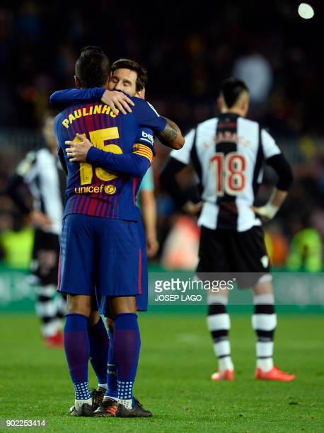 Barcelona's Brazilian midfielder Paulinho celebrates a goal with Barcelona's Argentinian forward Lionel Messi during the Spanish league football...
