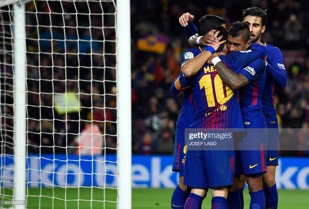 Barcelona's Brazilian midfielder Paulinho (2R) celebrates a goal with teammates during the Spanish league football match FC Barcelona vs Levante UD at the Camp Nou stadium in Barcelona on January 7, 2018. / AFP PHOTO / Josep LAGO