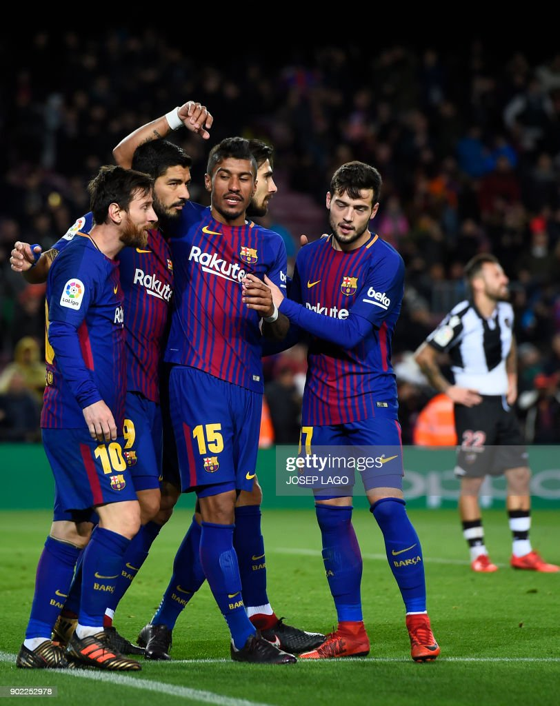 Barcelona's Brazilian midfielder Paulinho (3L) celebrates a goal with teammates during the Spanish league football match FC Barcelona vs Levante UD at the Camp Nou stadium in Barcelona on January 7, 2018. / AFP PHOTO / Josep LAGO