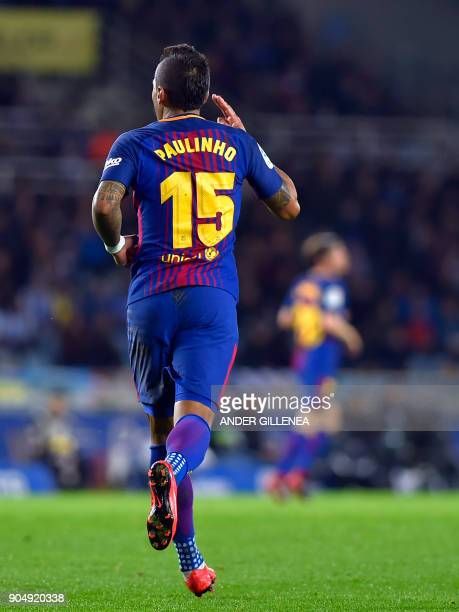 Barcelona's Brazilian midfielder Paulinho celebrates after scoring his team's first goal during the Spanish league football match between Real...
