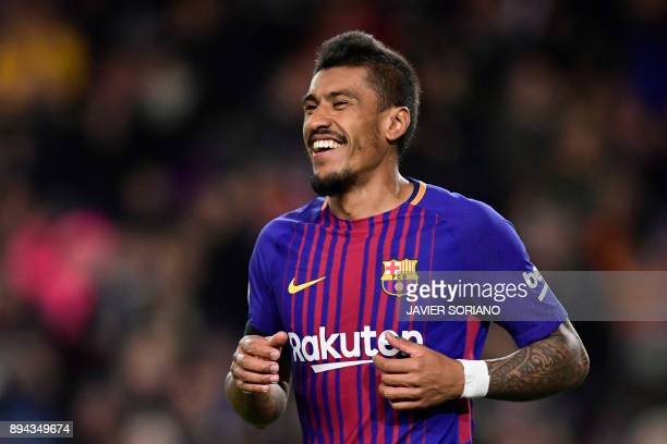 Barcelona's Brazilian midfielder Paulinho celebrates after scoring during the Spanish league football match FC Barcelona against RC Deportivo de la...