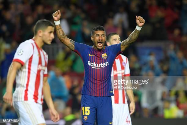 Barcelona's Brazilian midfielder Paulinho celebrates Barcelona's French defender Lucas Digne's goal during the UEFA Champions League group D football...
