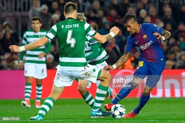 Barcelona's Brazilian midfielder Paulinho challenges Sporting's Portuguese midfielder Fabio Coentrao and Sporting's Uruguayan defender Sebastien...