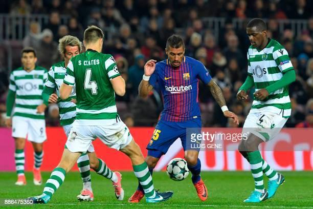 Barcelona's Brazilian midfielder Paulinho challenges Sporting's Portuguese midfielder Fabio Coentrao Sporting's Uruguayan defender Sebastien Coates...