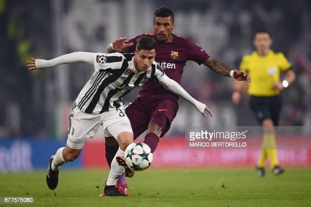 Barcelona's Brazilian midfielder Paulinho fights for the ball with Juventus' midfielder from Uruguay Rodrigo Bentancur during the UEFA Champions...