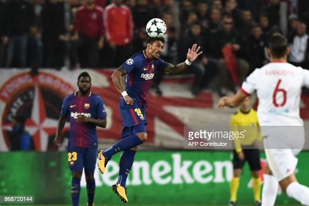 Barcelona's Brazilian midfielder Paulinho heads the ball during the UEFA Champions League group D football match between FC Barcelona and Olympiakos...