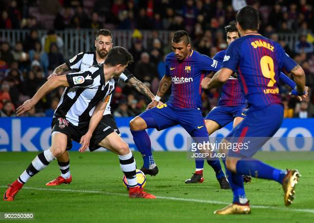Barcelona's Brazilian midfielder Paulinho prepares to shoot and score a goal during the Spanish league football match FC Barcelona vs Levante UD at...