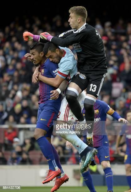 Barcelona's Brazilian midfielder Paulinho vies with Celta's defender Hugo Mallo and Celta's goalkeeper Ruben Blanco during the Spanish league...