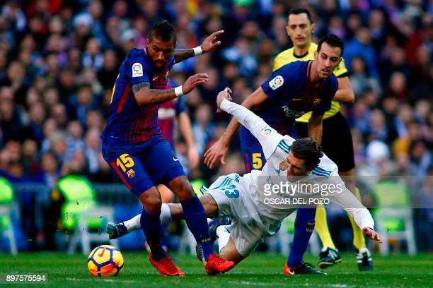 Barcelona's Brazilian midfielder Paulinho vies with Real Madrid's Croatian midfielder Mateo Kovacic during the Spanish League 'Clasico' football...
