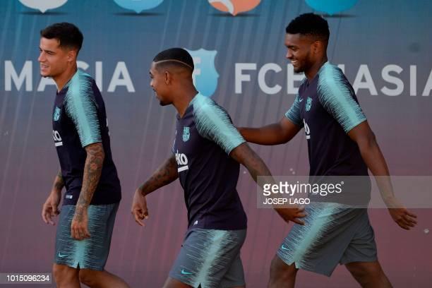 Barcelona's Brazilian midfielder Philippe Coutinho , Barcelona's Brazilian forward Malcom Oliveira and Barcelona's Brazilian defender Marlon Santos...