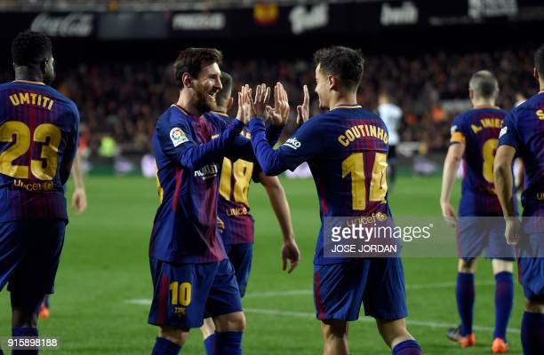Barcelona's Brazilian midfielder Philippe Coutinho celebrates a goal with Barcelona's Argentinian forward Lionel Messi during the Spanish 'Copa del...