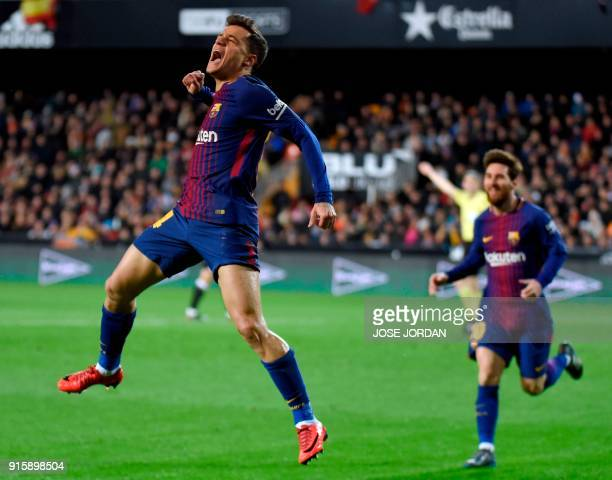 Barcelona's Brazilian midfielder Philippe Coutinho celebrates a goal as Barcelona's Argentinian forward Lionel Messi approaches during the Spanish...
