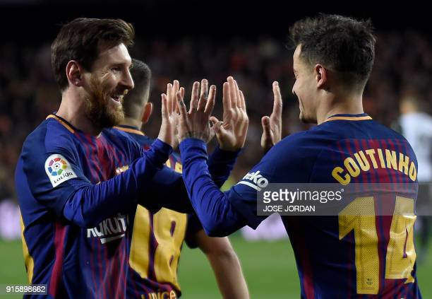 TOPSHOT Barcelona's Brazilian midfielder Philippe Coutinho celebrates a goal with Barcelona's Argentinian forward Lionel Messi during the Spanish...