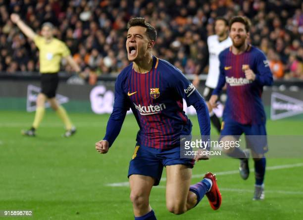 TOPSHOT Barcelona's Brazilian midfielder Philippe Coutinho celebrates a goal during the Spanish 'Copa del Rey' second leg semifinal football match...