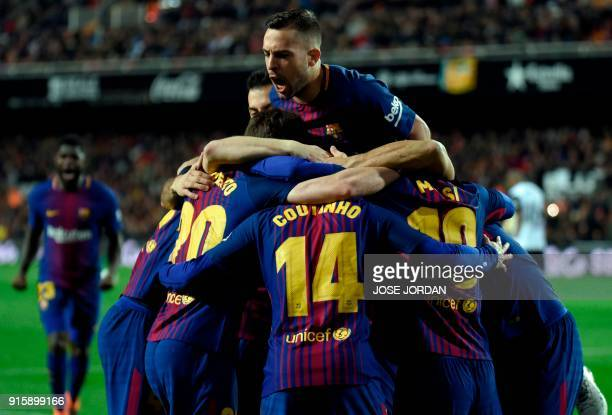 Barcelona's Brazilian midfielder Philippe Coutinho celebrates a goal with teammates during the Spanish 'Copa del Rey' second leg semifinal football...