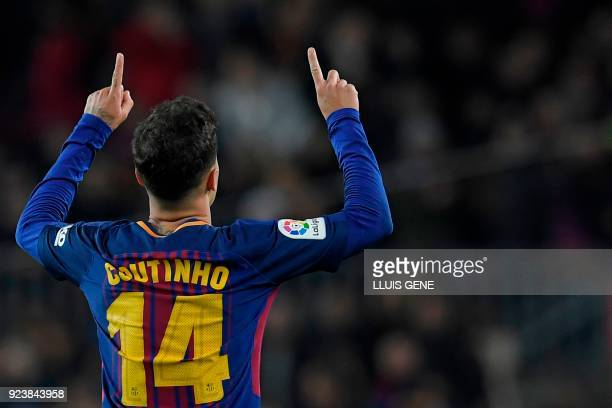 Barcelona's Brazilian midfielder Philippe Coutinho celebrates after scoring during the Spanish league football match between FC Barcelona and Girona...