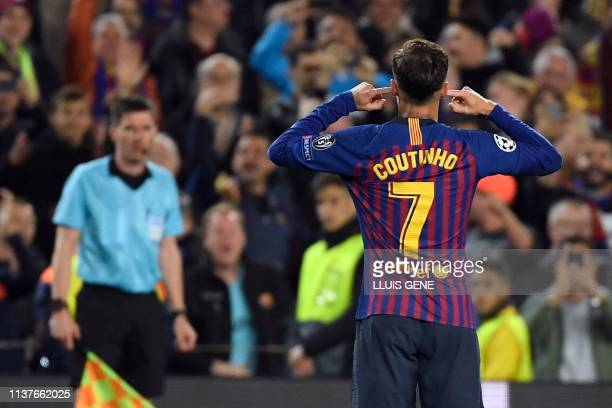 Barcelona's Brazilian midfielder Philippe Coutinho celebrates scoring his team's third goal during the UEFA Champions League quarterfinal second leg...