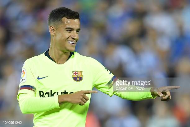 Barcelona's Brazilian midfielder Philippe Coutinho celebrates the opening goal the Spanish league football match Club Deportivo Leganes SAD against...