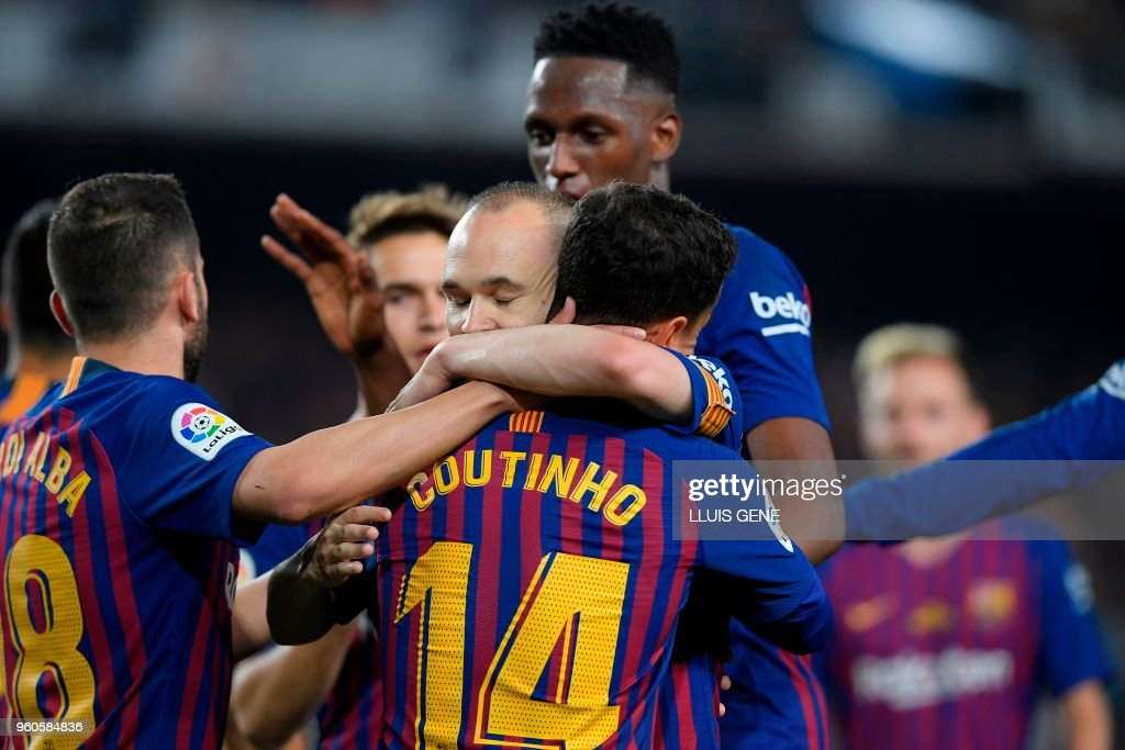 TOPSHOT - Barcelona's Brazilian midfielder Philippe Coutinho (C) celebrates with teammates after scoring a goal during the Spanish league football match between FC Barcelona and Real Sociedad at the Camp Nou stadium in Barcelona on May 20, 2018.